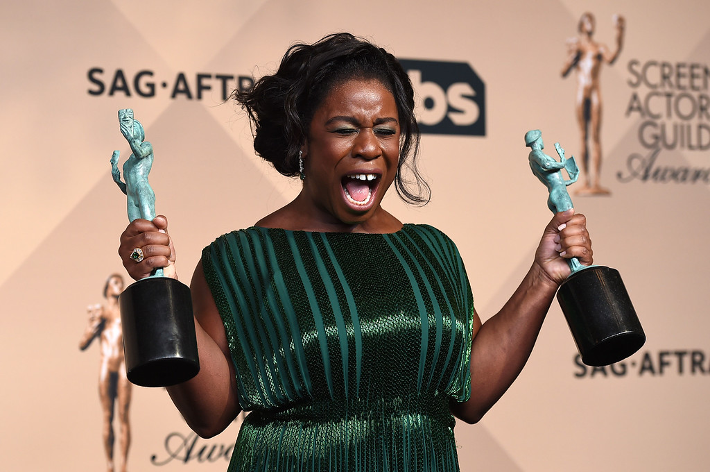 """. Uzo Aduba poses in the press room at the 22nd annual Screen Actors Guild Awards at the Shrine Auditorium & Expo Hall on Saturday, Jan. 30, 2016, in Los Angeles. Aduba won the award for outstanding actress in a comedy series and outstanding ensemble cast for \""""Orange is the New Black.\"""" (Photo by Jordan Strauss/Invision/AP)"""