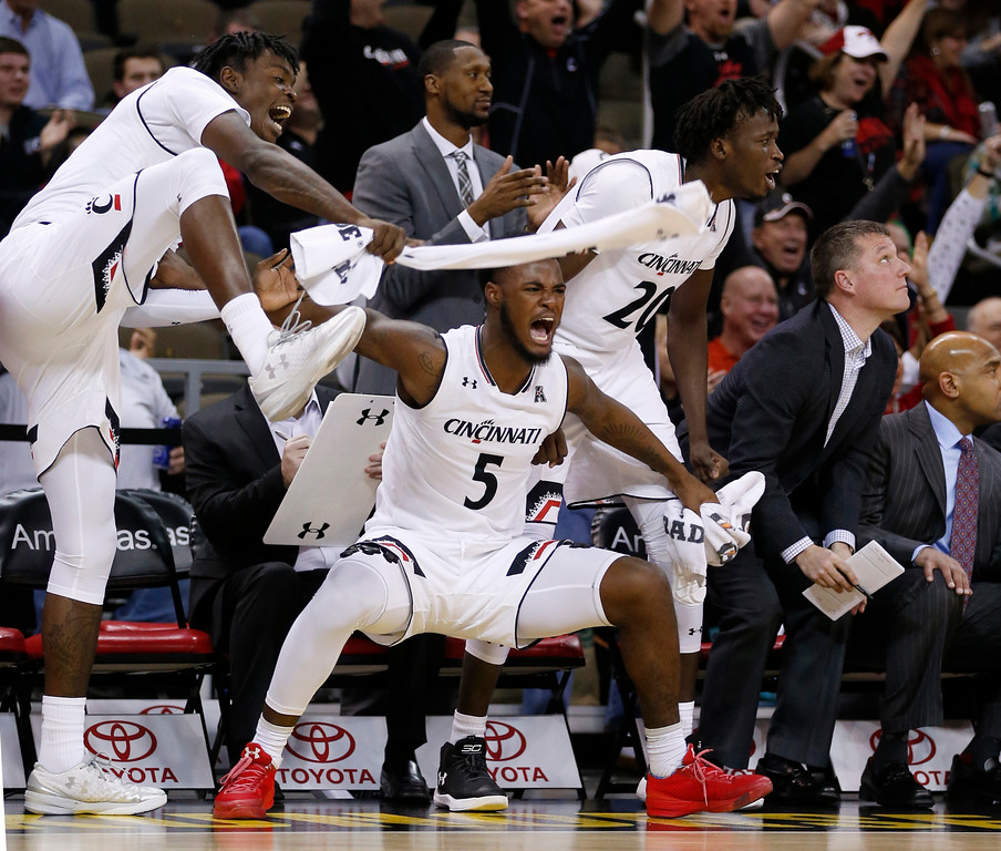 . Cincinnat\'s Trevon Scott, Trevor Moore and Mamoudou Diarra, from left, celebrate a teammate\'s dunk during the second half of an NCAA college basketball game against Cleveland State, Thursday, Dec. 21, 2017, in Highland Heights, Ky. Cincinnati won 81-62. (AP Photo/Gary Landers)