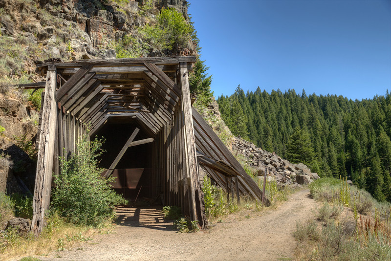 This tunnel was built on the Oregon Short Line spur between Ashton, ID and West Yellowstone, MT in 1915 because frequent rockslides were delaying the tourists headed to Yellowstone.
