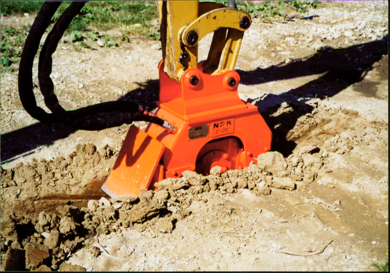 NPK C2C compactor with backfill blade on Cat mini excavator (5).JPG