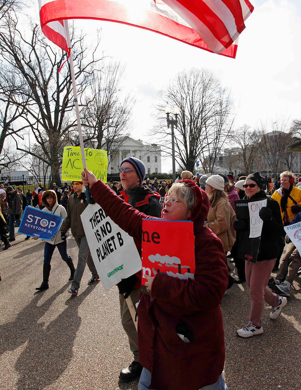 . Demonstrators march past the White House during a rally against the Keystone XL pipeline in Washington, February 17, 2013. The TransCanada Corp pipeline would link the oil sands of northern Alberta, the world\'s third largest crude resource, to refineries and ports in Texas.  Environmentalists say approval of the pipeline will encourage more development in the oil sands, where extraction is carbon intensive, leading to greater greenhouse gas emissions.REUTERS/Richard Clement