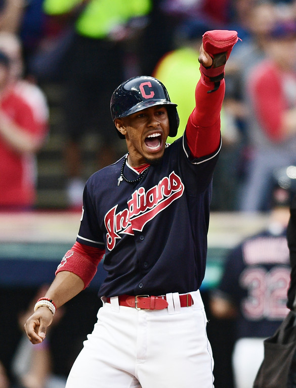 . Cleveland Indians\' Francisco Lindor reacts toward first base at Carlos Santana after scoring on a single by Santana in the first inning of Game 2 of baseball\'s American League Division Series against the New York Yankees, Friday, Oct. 6, 2017, in Cleveland. (AP Photo/David Dermer)