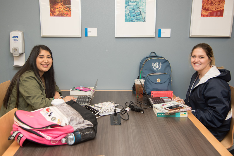 Brianna Arciniega (left) and Alexis West study for their History class at the Mary and Jeff Bell Library.