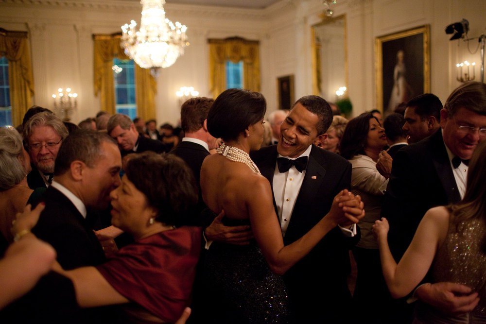"Description of . Feb. 22, 2009 ""This was the first formal function at the White House in the administration: the Governors Ball. The President dances with his wife while singing along with the band Earth, Wind and Fire."" (Official White House photo by Pete Souza)"