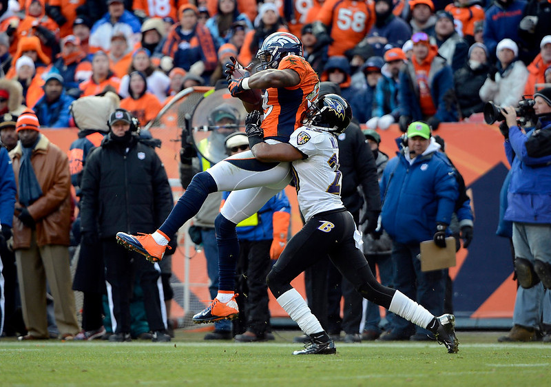 . Denver Broncos wide receiver Demaryius Thomas (88) gets taken down by Baltimore Ravens cornerback Cary Williams (29) during the first quarter.  The Denver Broncos vs Baltimore Ravens AFC Divisional playoff game at Sports Authority Field Saturday January 12, 2013. (Photo by Hyoung Chang,/The Denver Post)