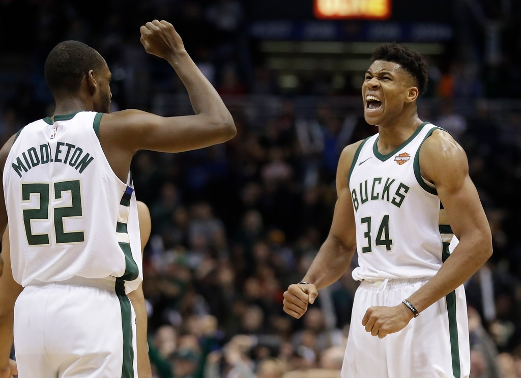 . Milwaukee Bucks\' Giannis Antetokounmpo celebrates with Khris Middleton (22) after making a basket and being fouled during the second half of an NBA basketball game against the Cleveland Cavaliers Tuesday, Dec. 19, 2017, in Milwaukee. The Bucks won 119-116. (AP Photo/Morry Gash)