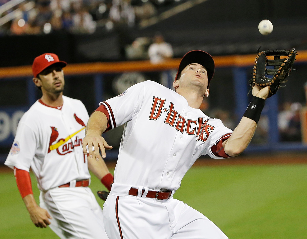 . National League�s Paul Goldschmidt, right, of the Arizona Diamondbacks, catches a foul ball hit by American League�s Miguel Cabrera, of the Detroit Tigers, ?during the sixth inning of the MLB All-Star baseball game, on Tuesday, July 16, 2013, in New York. (AP Photo/Matt Slocum)