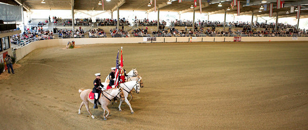 The arena at the LA Equistrian Center. Out of Barstow, CA, This mounted Marine color guard is the last mounted color guard in the Corps.  The horses were wild mustangs running free in California and Nevada and procured through the BLM's Mustang Rescue Program.