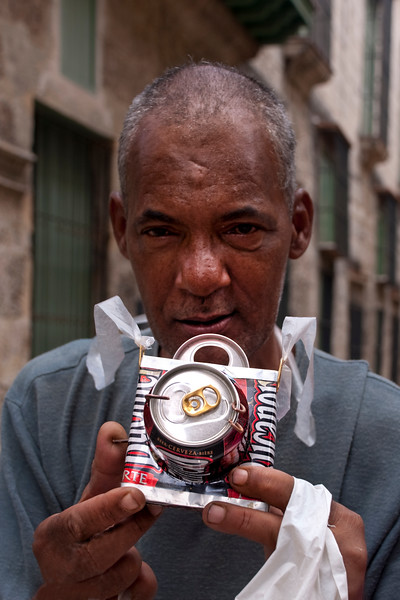 """This man wanted to """"take our picture"""" with his beer-can camera.  We took his and bought the """"camera""""."""
