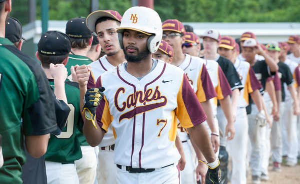 05/30/18 Wesley Bunnell | Staff New Britain baseball defeated Enfield 4-3 with a walk off bases loaded single in the bottom of the 7th in a first round CIAC Class LL tournament game. Josh Garcia (7) and teammates line up for the hand shake.