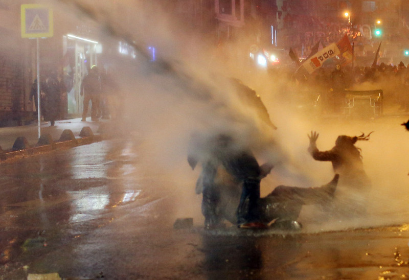 . Protesters are hit by water cannon during clashes with riot police in Kadikoy, on the Anatolian side of Istanbul, on March 11, 2014. Turkish riot police fired tear gas Tuesday at protesters massed outside a hospital after the death of a teenage boy wounded during anti-government protests last year and left comatose. About 1,000 people staged a rally outside an Istanbul hospital in solidarity with 15-year-old Berkin Elvan, who was walking to buy bread when he was struck in the head by a tear gas canister during the unrest in the city in June.  (GURCAN OZTURK/AFP/Getty Images)
