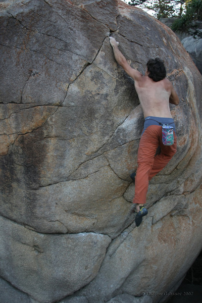 Trent on the best bouldering problem ever at Magnetic Island. The dyno sequence. Photo by Andrew Grosser