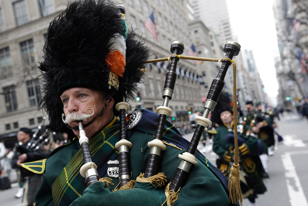 . Bagpipers march up Fifth Avenue during the St. Patrick\'s Day Parade, Tuesday, March 17, 2015, in New York.  The parade stepped off with a jovial Cardinal Timothy Dolan as grand marshal. (AP Photo/Mary Altaffer)