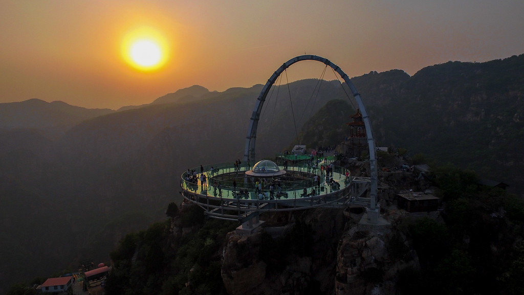 . This photo taken on April 30, 2016 shows a glass sightseeing platform in Shilinxia scenic spot in Pinggu District of Beijing.  The sightseeing platform, which hangs 32.8 meters out from the cliff, is claimed to be the largest glass sightseeing platform in the world. / AFP PHOTO / STR //AFP/Getty Images