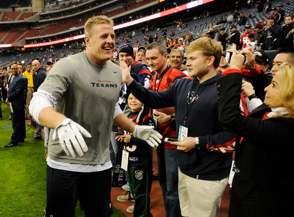 Description of . Houston Texans defensive end J.J. Watt greets spectators as he leaves the field before an NFL wild card playoff football game against the Cincinnati Bengals Saturday, Jan. 5, 2013, in Houston. (AP Photo/Dave Einsel)