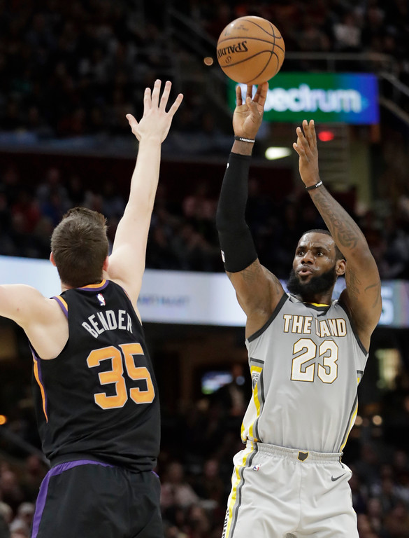 . Cleveland Cavaliers\' LeBron James (23) shoots over Phoenix Suns\' Dragan Bender (35) during the second half of an NBA basketball game Friday, March 23, 2018, in Cleveland. The Cavaliers won 120-95. (AP Photo/Tony Dejak)