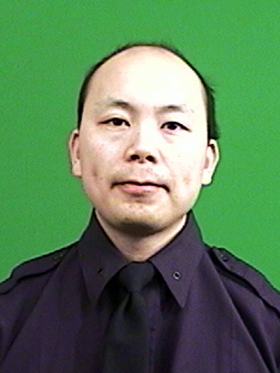 . This photo provided by the New York Police Department shows officer Wenjian Liu. Liu and officer Rafael Ramos where shot and killed Saturday, Dec. 20, 2014, in the Brooklyn borough of New York. The suspect, 28-year-old Ismaaiyl Brinsley, ran to a subway station and killed himself. (AP Photo/New York Police Department)