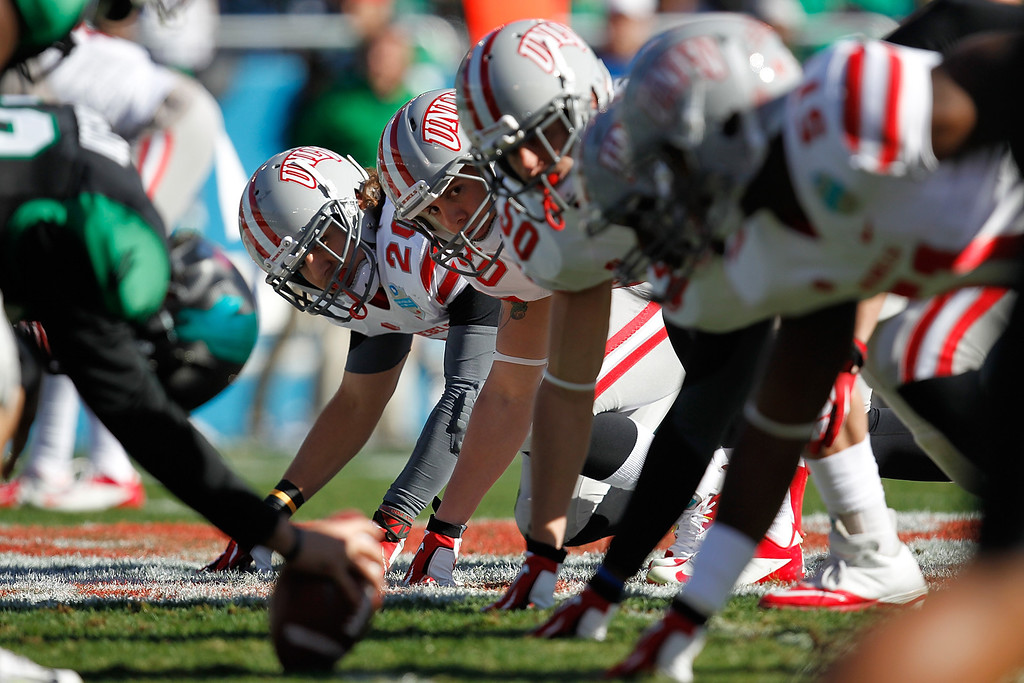 . DALLAS, TX - JANUARY 01: Matt Vinal #20 and Trent Langham #50 of the UNLV Rebels prepare for the snap against the North Texas Mean Green during the Heart of Dallas Bowl at Cotton Bowl Stadium on January 1, 2014 in Dallas, Texas.  (Photo by Sarah Glenn/Getty Images)