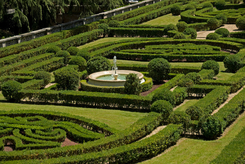 Fountain in the middle of geometric hedges in Vatican City Gardens - Rome, Italy