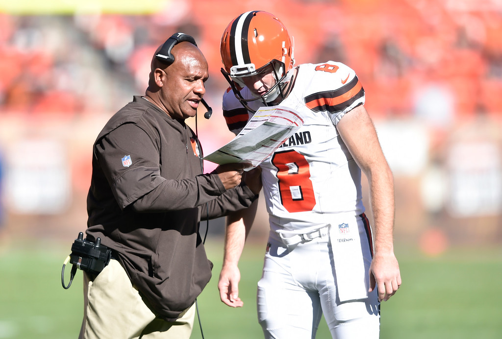 . Cleveland Browns head coach Hue Jackson talks with quarterback Kevin Hogan (8) between plays against the Cincinnati Bengals during an NFL football game, Sunday, Oct. 1, 2017, in Cleveland. Cincinnati won 31-7. (AP Photo/David Richard)
