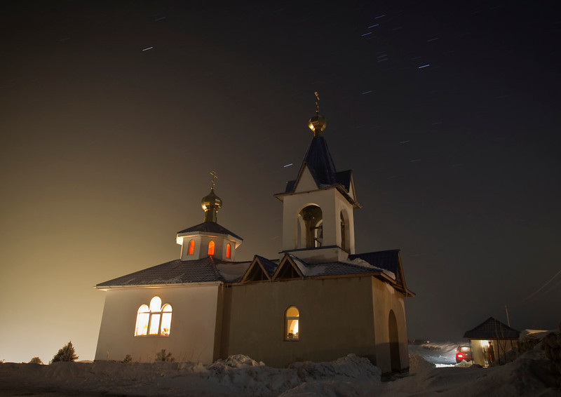 . A general view of a small Orthodox church during a night Epiphany service, some 45 km (28 miles) east of Almaty, Kazakhstan, January 18, 2013. Orthodox believers immerse themselves in icy waters regardless of the weather, an age-old ritual which commemorates the baptism of Jesus Christ in the Jordan River, or the Epiphany, which the Russian Orthodox Church celebrates on January 19. Picture taken January 18. REUTERS/Shamil Zhumatov