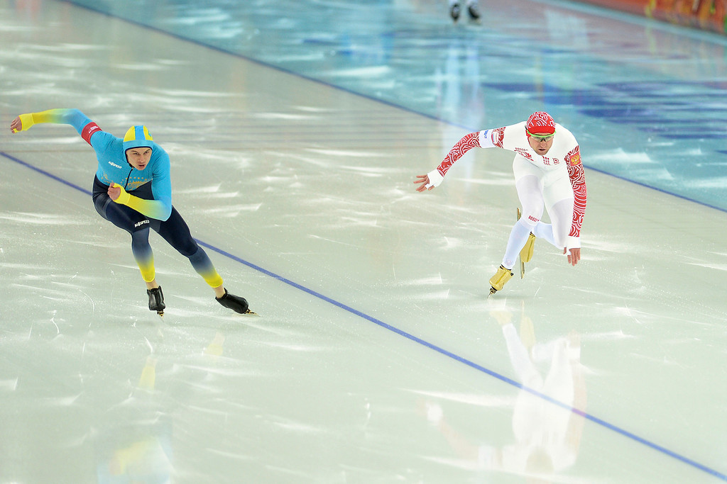 . Roman Krech of Kazakstan (left) and Aleksey Yesin of Russia race during the speed skating men\'s 500-meter at Adler Arena. Sochi 2014 Winter Olympics on Monday, February 10, 2014. (Photo by AAron Ontiveroz/The Denver Post)