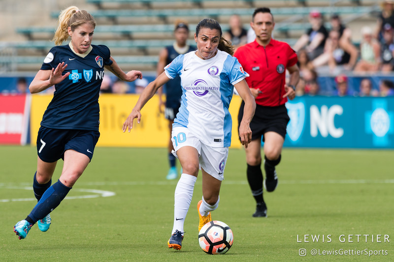 Marta (10) and McCall Zerboni (7) during a match between the NC Courage and the Orlando Pride in Cary, NC in Week 3 of the 2017 NWSL season. Photo by Lewis Gettier.