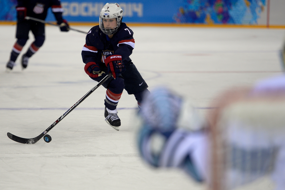 . U.S.A. forward Monique Lamoureaux controls the puck as she takes Finland goalie Noora Raty one on one during the third period of the United States\' 3-1 win against Finland. Sochi 2014 Winter Olympics on Saturday, February 8, 2014. (Photo by AAron Ontiveroz/The Denver Post)