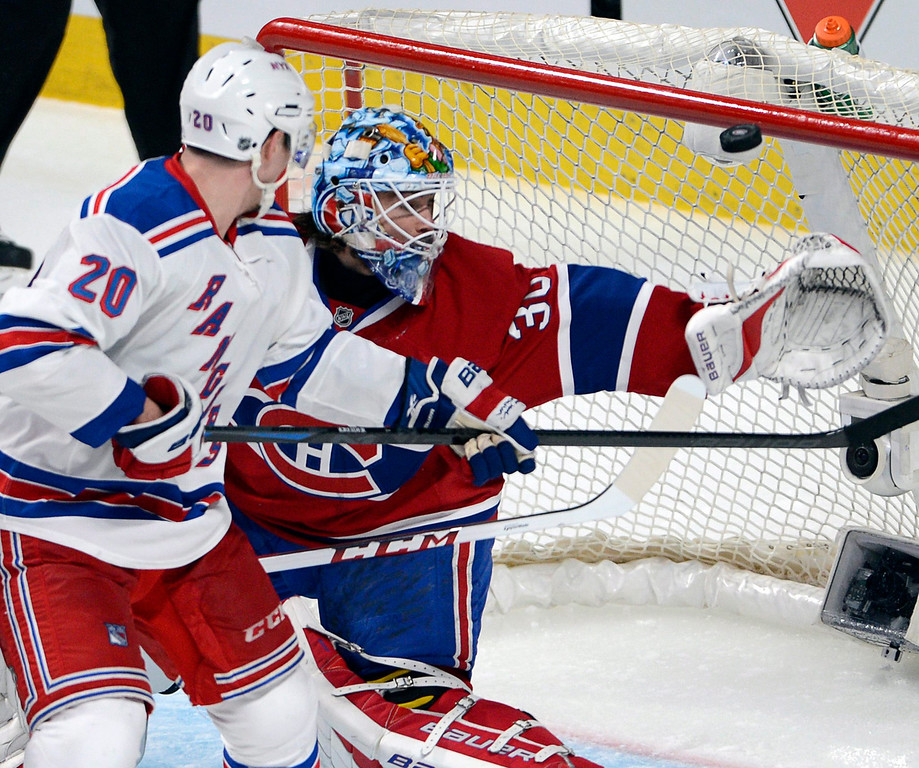 . Montreal Canadiens goalie Peter Budaj (30) makes a save on New York Rangers left wing Chris Kreider (20) during the third period in Game 1 of the Eastern Conference finals in the NHL hockey Stanley Cup playoffs in Montreal on Saturday, May 17, 2014. The Rangers won 7-2. (AP Photo/The Canadian Press, Ryan Remiorz)