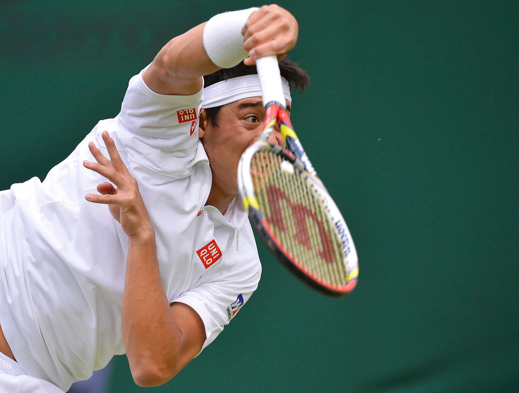. Kei Nishikori of Japan serves to Matthew Ebden of Australia during their men\'s singles tennis match at the Wimbledon Tennis Championships, in London June 25, 2013.  REUTERS/Toby Melville