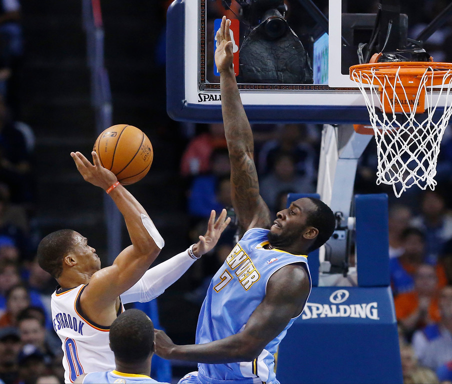 . Oklahoma City Thunder guard Russell Westbrook (0) shoots as Denver Nuggets forward J.J. Hickson (7) defends in the second quarter of an NBA basketball game in Oklahoma City, Monday, Nov. 18, 2013. (AP Photo/Sue Ogrocki)