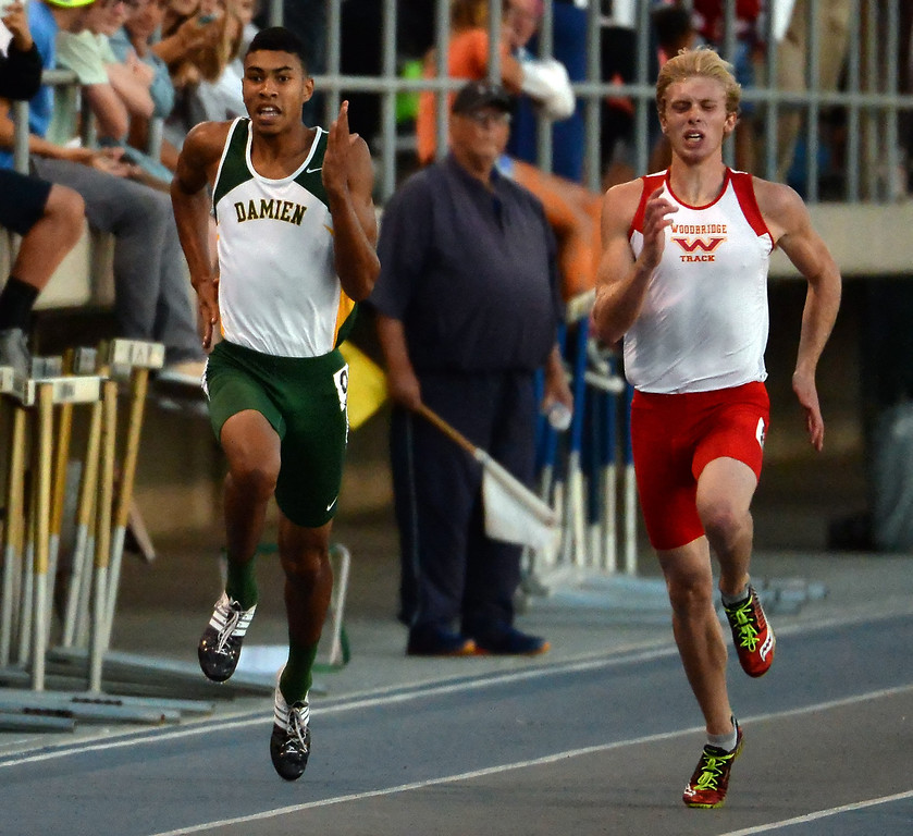 . Damien\'s Thaddeus Smith, left, competes in the 200 meter dash during the CIF-SS Masters Track and Field meet at Falcon Field on the campus of Cerritos College in Norwalk, Calif., on Friday, May 30, 2014.   (Keith Birmingham/Pasadena Star-News)