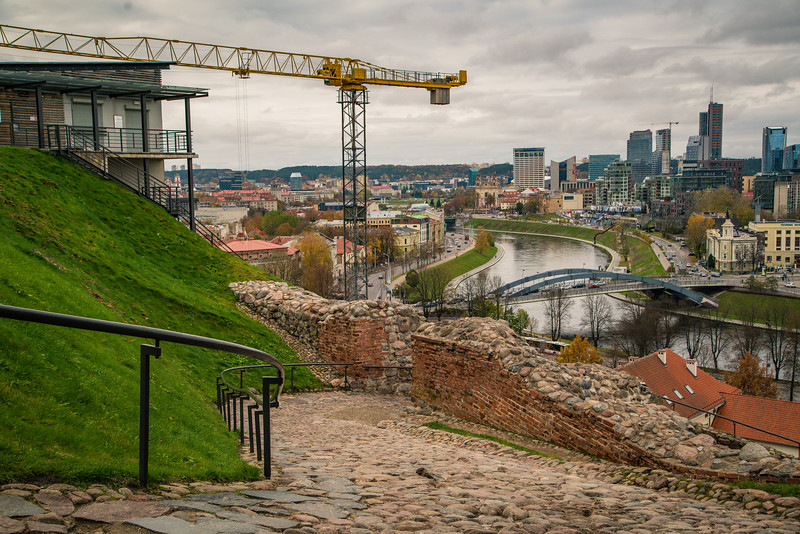 Looking north across the Neris River from Gediminas Tower. At the crossroads of Old Town and modern Vilnius. Vilnius, Lithuania. November 2017.