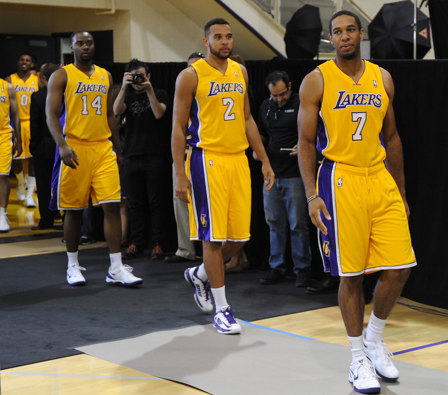 . Lakers#14 Marcus Landry #2 Elias Harris, #7 Xavier Henry and Robert Sacre enter the practice court for media day.The Los Angeles Lakers held a media day at their El Segundo practice facility. Players were photographed for team materials, and interviewed by the press. El Segundo, CA. 9/27/2013. photo by (John McCoy/Los An8eles Daily News)