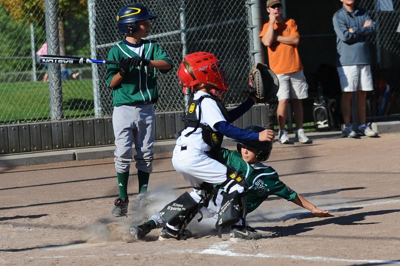 Chad Lincoln (at bat), Jacob Andreatta (sliding into home)