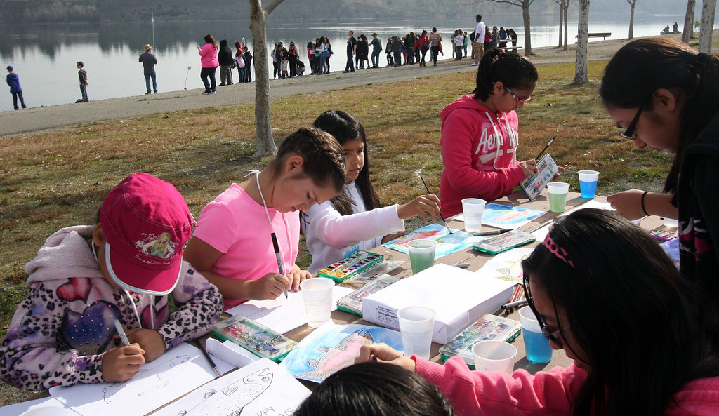. Students create pictures of fish as part of the Trout in the Classroom program, sponsored by the State Department of Fish and Wildlife, at Shadow Cliffs Regional Recreation Area in Pleasanton, Calif., on Thursday, March 14, 2013. Classes are given 35 trout eggs and tanks. When the hatchlings are large enough, they are released into local lakes.  (Jim Stevens/Staff)