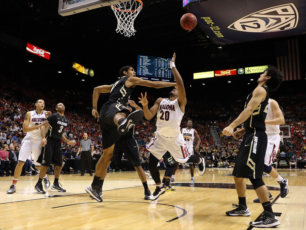 . Jordin Mayes #20 of the Arizona Wildcats goes up for a shot in the lane against Josh Scott #40 of the Colorado Buffaloes in the second half during the quarterfinals of the Pac-12 tournament at the MGM Grand Garden Arena on March 14, 2013 in Las Vegas, Nevada.  (Photo by Jeff Gross/Getty Images)