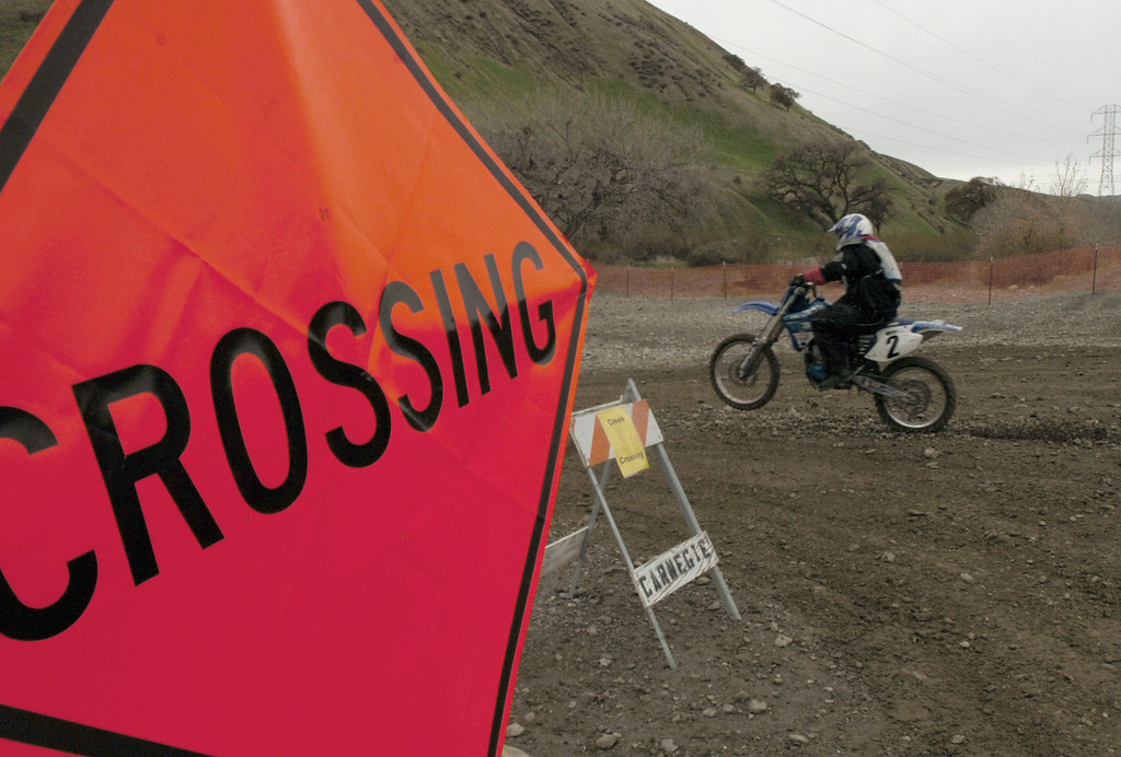 . A rider uses one of four designated creek crossings while making a run before a rally at Carnegie State Vehicular Recreation Area on Dec. 28, 2009, in Tracy, Calif., to save the off-road facility on Corral Hollow Road. In September, the Sportfishing Alliance and Public Employees for Environmental Responsibility sued the state, saying Carnegie lacked a permit from a state water board to allow pollution to flow into Corral Hollow Creek. If a stay to the ruling to close the park is not granted, dirt bikes and other all-terrain vehicles will be banned from Carnegie on Tuesday. (Cindi  Christie/Staff Archives)