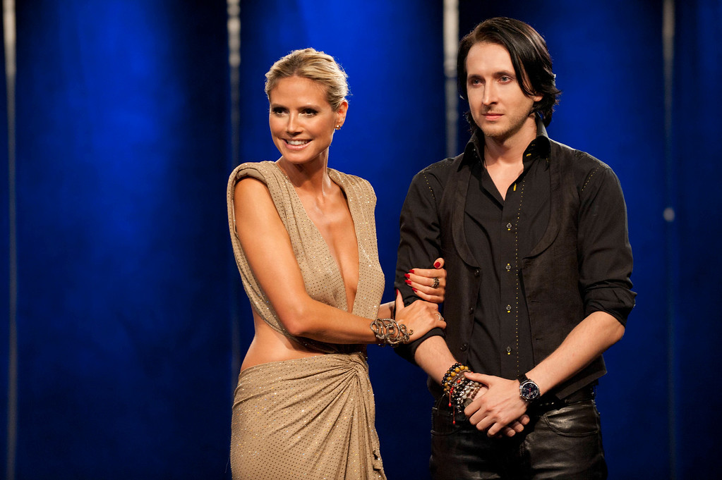. Project Runway (L to R) Heidi Klum with Project Runway season 10 winner Dmitry Sholokhov in the season finale, airing Thursday, October 18, at 9pm ET/PT on Lifetime. Photo by Barbara Nitke Copyright 2011