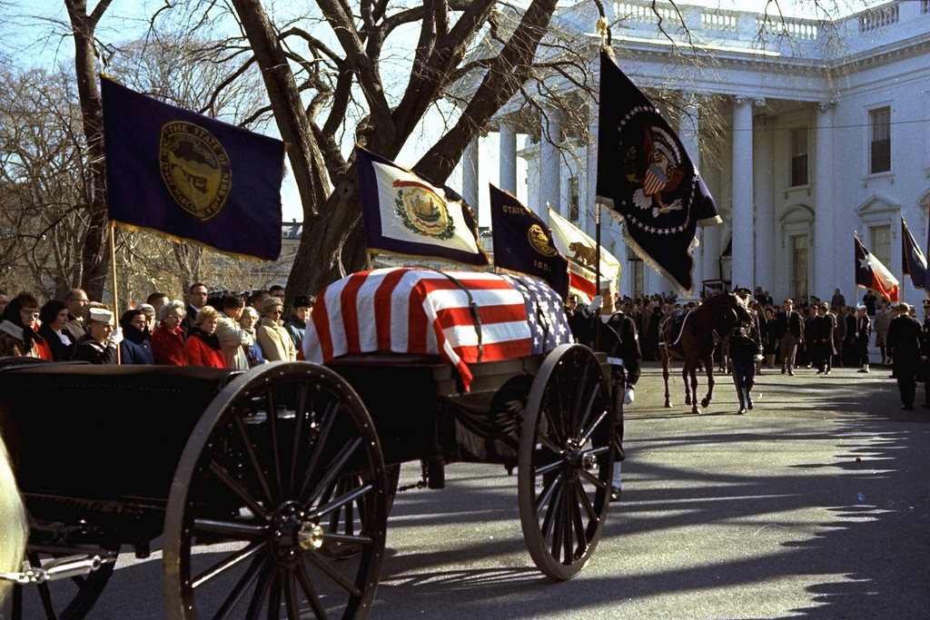 . The caisson bearing the flag-draped coffin of President John F. Kennedy, is shown leaving the White House in procession down Pennsylvania Avenue, in Washington, en route to Arlington National Cemetery, November 25, 1963.  (AP Photo)
