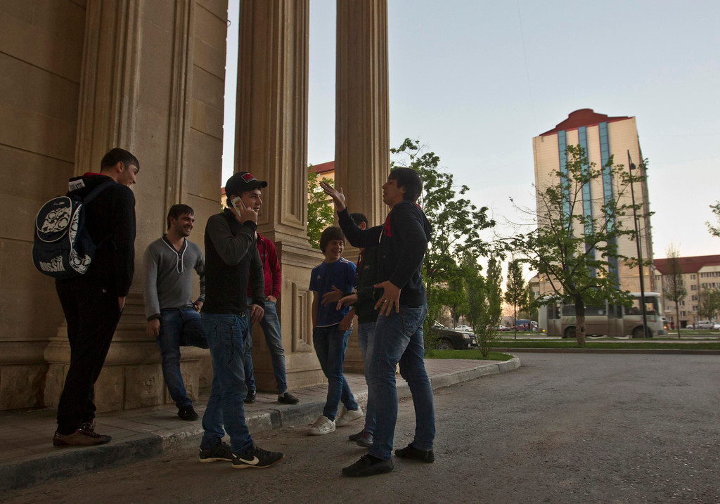 . A group of young Chechen men hang out on a street corner in the centre of the Chechen capital Grozny April 29, 2013. The naming of two Chechens, Dzhokhar and Tamerlan Tsarnaev, as suspects in the Boston Marathon bombings has put Chechnya - the former site of a bloody separatist insurgency - back on the world\'s front pages. Moscow has poured billions of roubles into rebuilding Chechnya, a mainly Muslim province that has seen centuries of war and repression. Picture taken April 29, 2013.   REUTERS/Maxim Shemetov