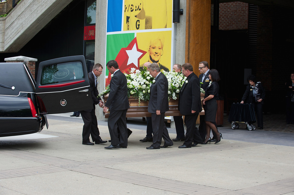 . Pallbearers  load the casket at the funeral service for George Jones at The Grand Ole Opry on May 2, 2013 in Nashville, Tennessee.   (Photo by Jason Davis/Getty Images)