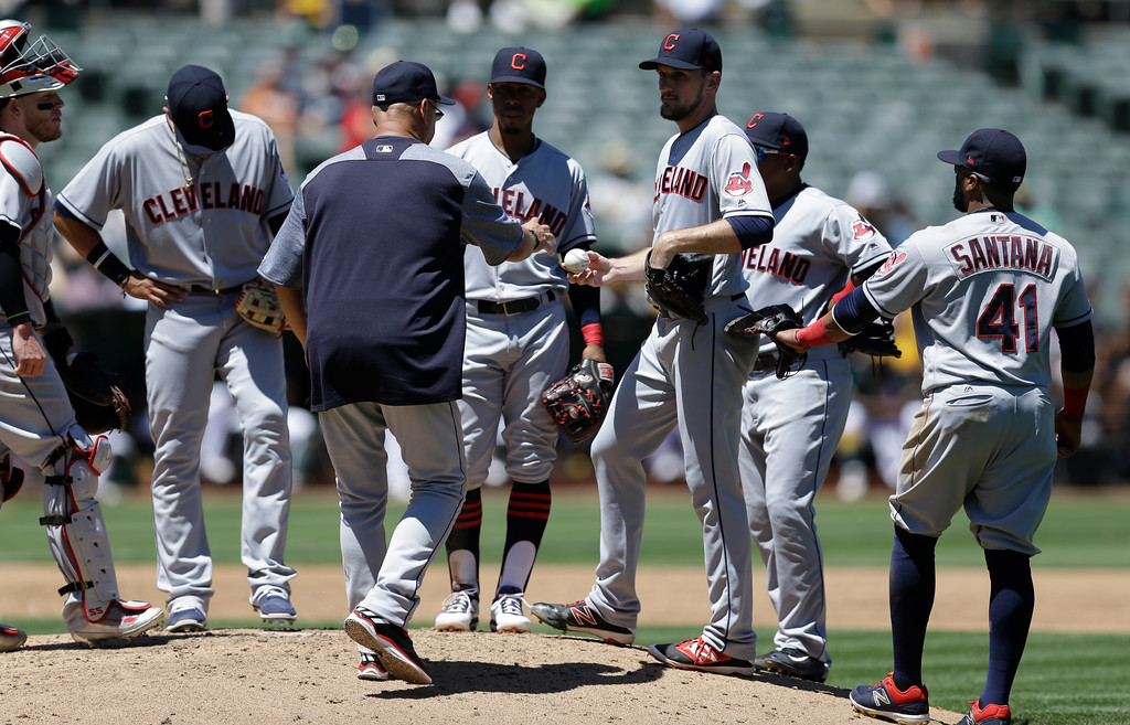 . Cleveland Indians\' Dan Otero, center right, hands the ball to manager Terry Francona as he is removed in the third inning of a baseball game against the Oakland Athletics, Sunday, July 16, 2017, in Oakland, Calif. (AP Photo/Ben Margot)