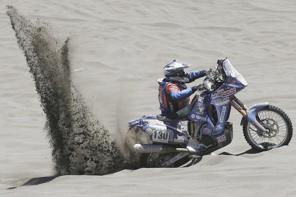 . French Gilles Gard in action during the second stage of the Rally Dakar 2014 between the Argentinean localities of San Luis and San Rafael, 06 January 2014. Rally Dakar will run between 4 and 18 January across Argentina, Bolivia and Chile.  EPA/Felipe Trueba