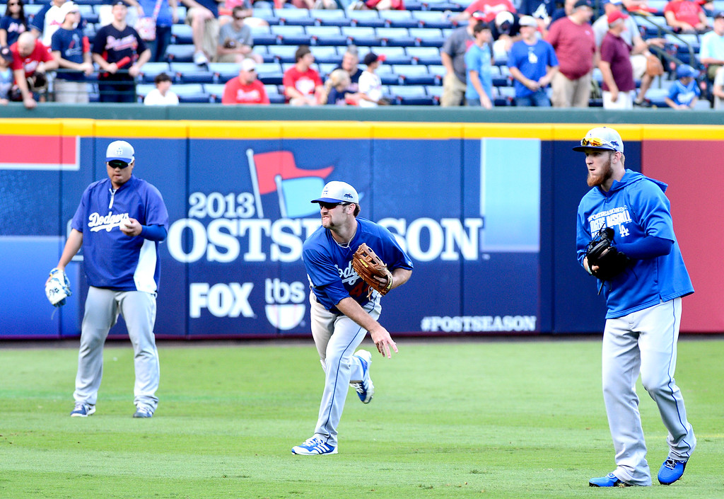 . The Dodgers get ready to play the Atlanta Braves in the first game of the playoffs Thursday, October 3, 2013 at Turner Field in Atlanta, Georgia. (Photo by Sarah Reingewirtz/Pasadena Star- News)