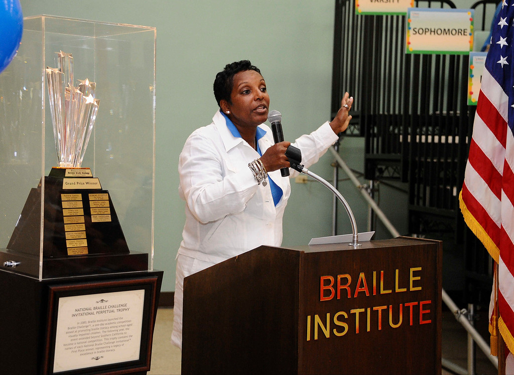 . June 22,2013 Los Angeles CA. Executive director of Braille Institute Anita Wright talks during the opening of the National Braille Challenge. These finalists were chosen from among more than 1000 blind and visually impaired students�representing 39 states and two Canadian provinces�during the preliminary round at Regional Braille Challenge events across the U.S. and Canada. They are a diverse group of high achievers�athletes, musicians and technology whiz kids. Most of them were born blind, but others lost their sight due to cancer or viral infections. They will be competing for up to $2500 in cash prizes, trophies and the latest adaptive equipment�including a Focus Blue 40 refreshable Braille display provided by Freedom Scientific, as well as an iPad sponsored by Palmer Langdon, to help connect them to the digital world.   Photo by Gene Blevins/LA Daily News