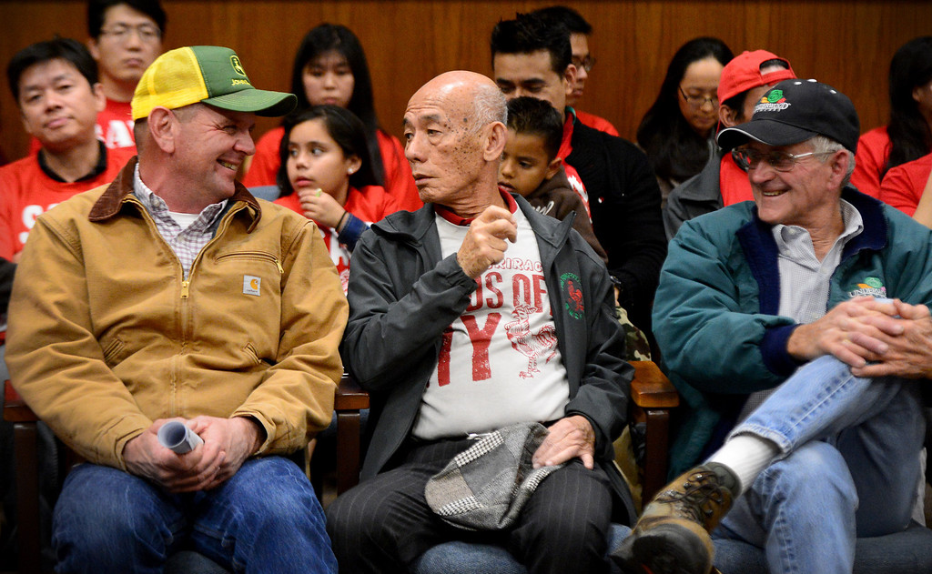 . David Tran, founder and CEO of Huy Fong Foods, sits with his chile growers Jim Roberts, left, and Craig Underwood, of Underwood Ranches, during a public hearing Wednesday night, February 26, 2014 at Irwindale City Council, on whether or not the smell coming from the Huy Fong Foods facility is creating a public nuisance. The city and the Sriracha maker have been entangled in a legal battle since the city filed a temporary restraining order to shut the factory down. The order was denied by a LA County Superior Court judge. (Photo by Sarah Reingewirtz/Pasadena Star-News)