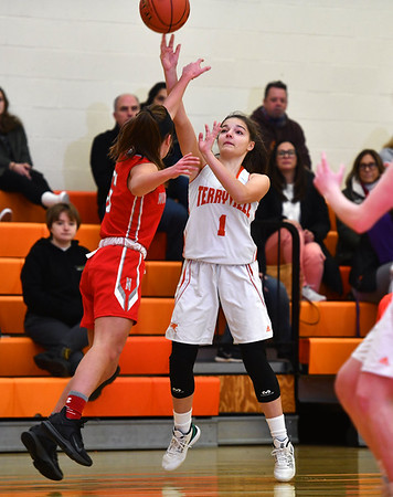 12/26/2019 Mike Orazzi | StaffrTerryville High School's Julianna Lloret (1) and Northwestern's Natalie Brodnitzki (5) during Thursday's girls basketball game in Terryville.