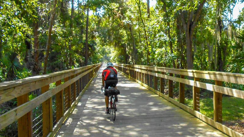 Cyclist on wooden bridge