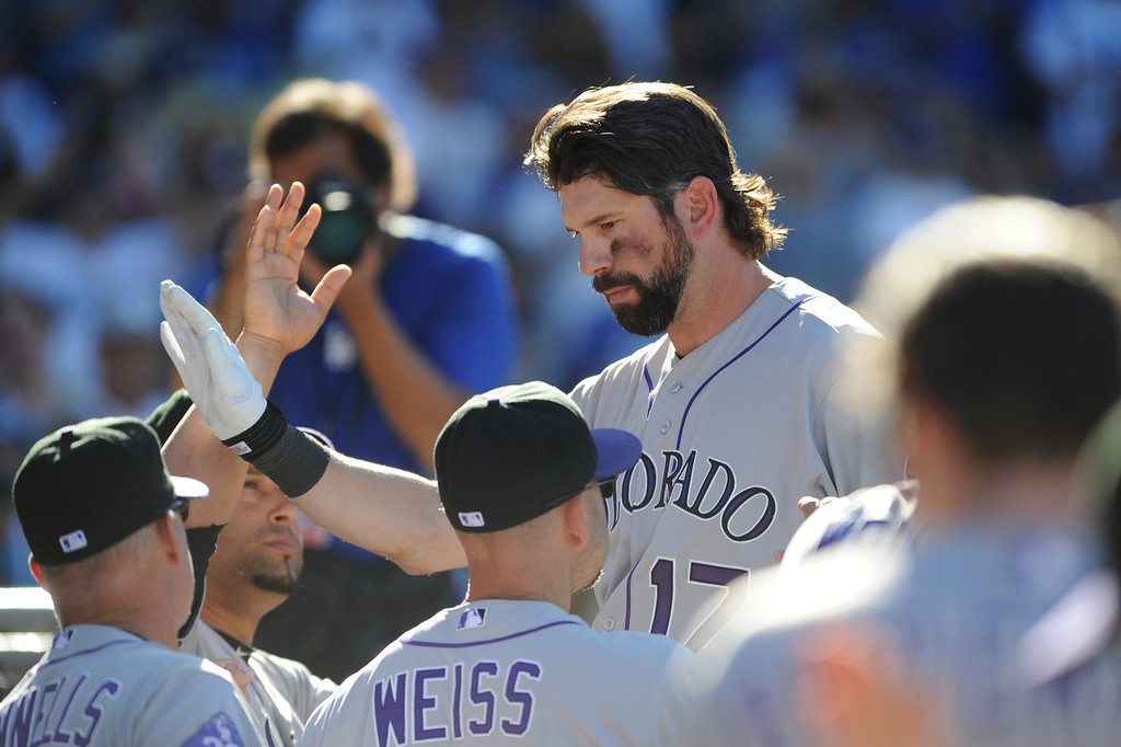 . Colorado Rockies\' Todd Helton returns to the dugout after his last at-bat Sunday, September 29, 2013, at Dodger Stadium. (Photo by Michael Owen Baker/L.A. Daily News)